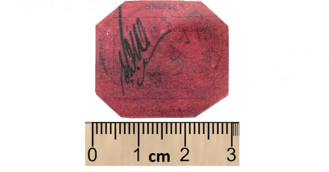 Picture of stamp next to ruler